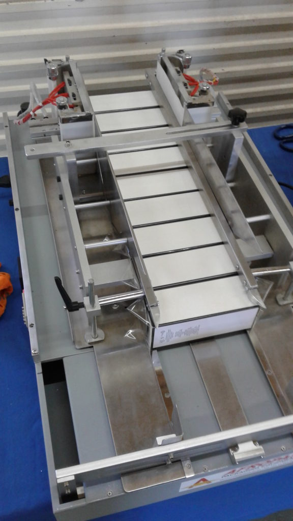 SEMI-AUTOMATIC OVER WRAPPING MACHINE afropak packaging equipment